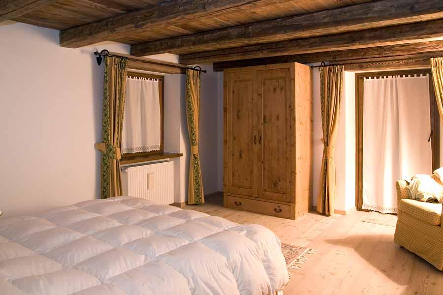 Camere rustiche in legno