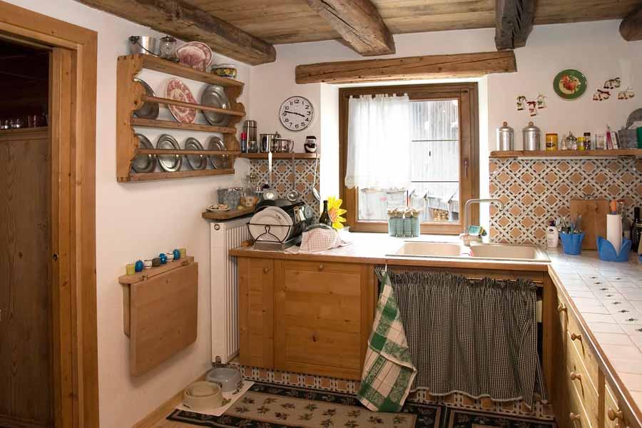 Cucine rustiche in legno for Immagini di case rustiche